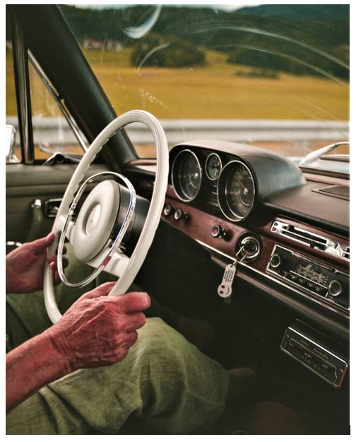 old man driving mercedes