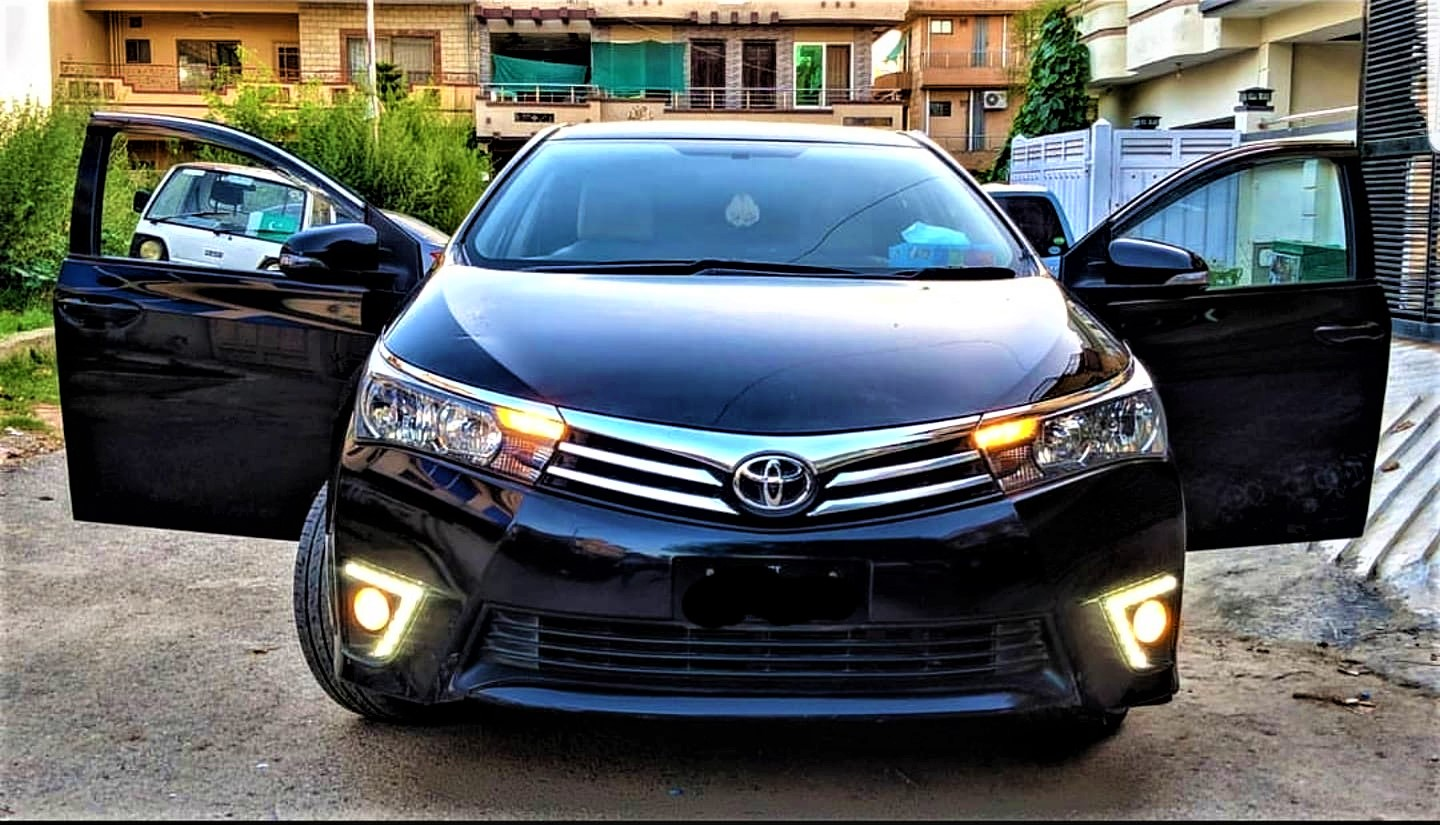 toyota corolla in black color with open doors